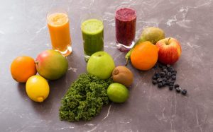 Three different smoothies with ingredients