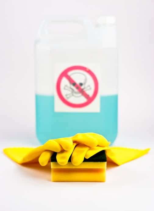 Toxic cleaning products with rubber gloves and sponge.